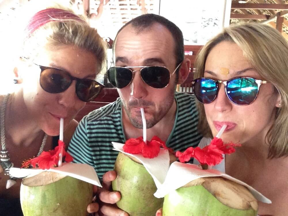 Us eating coconuts at Marari Beach Resort