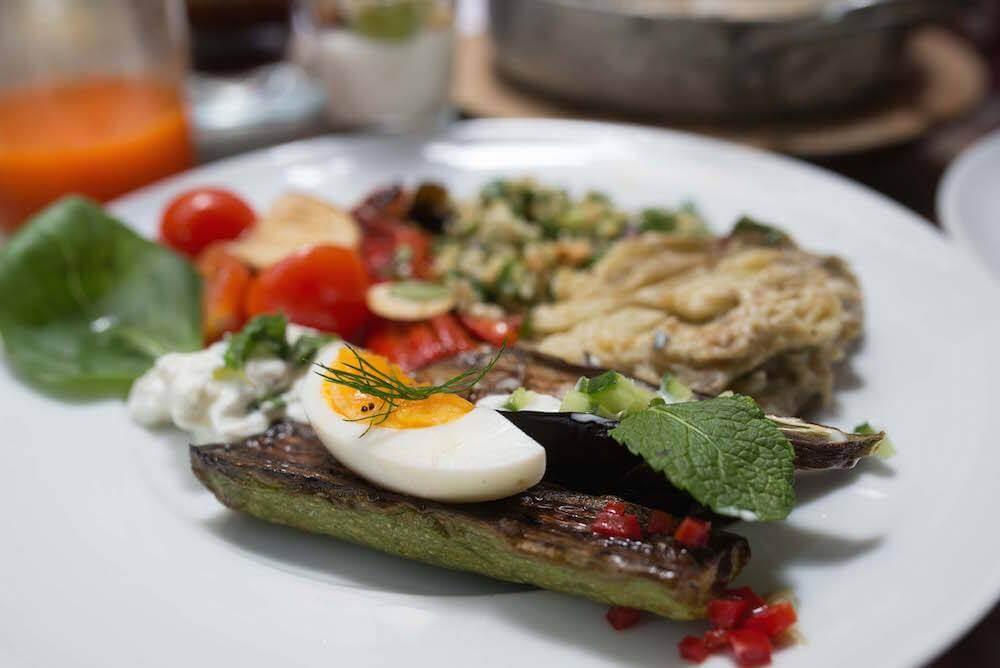 Israeli breakfast at Mendeli Hotel by Or Kaplan