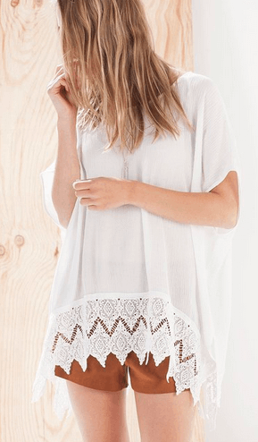 Poncho top with crochet hem