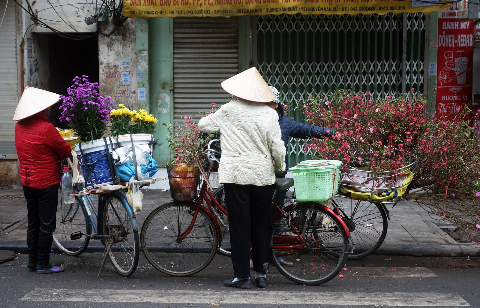 lady and a bike in vietnam