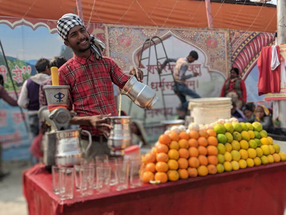 Friendly guy at the orange stand Kumbh Mela