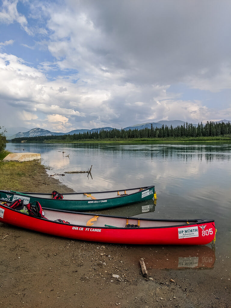 canoes on the yukon river in whitehorse