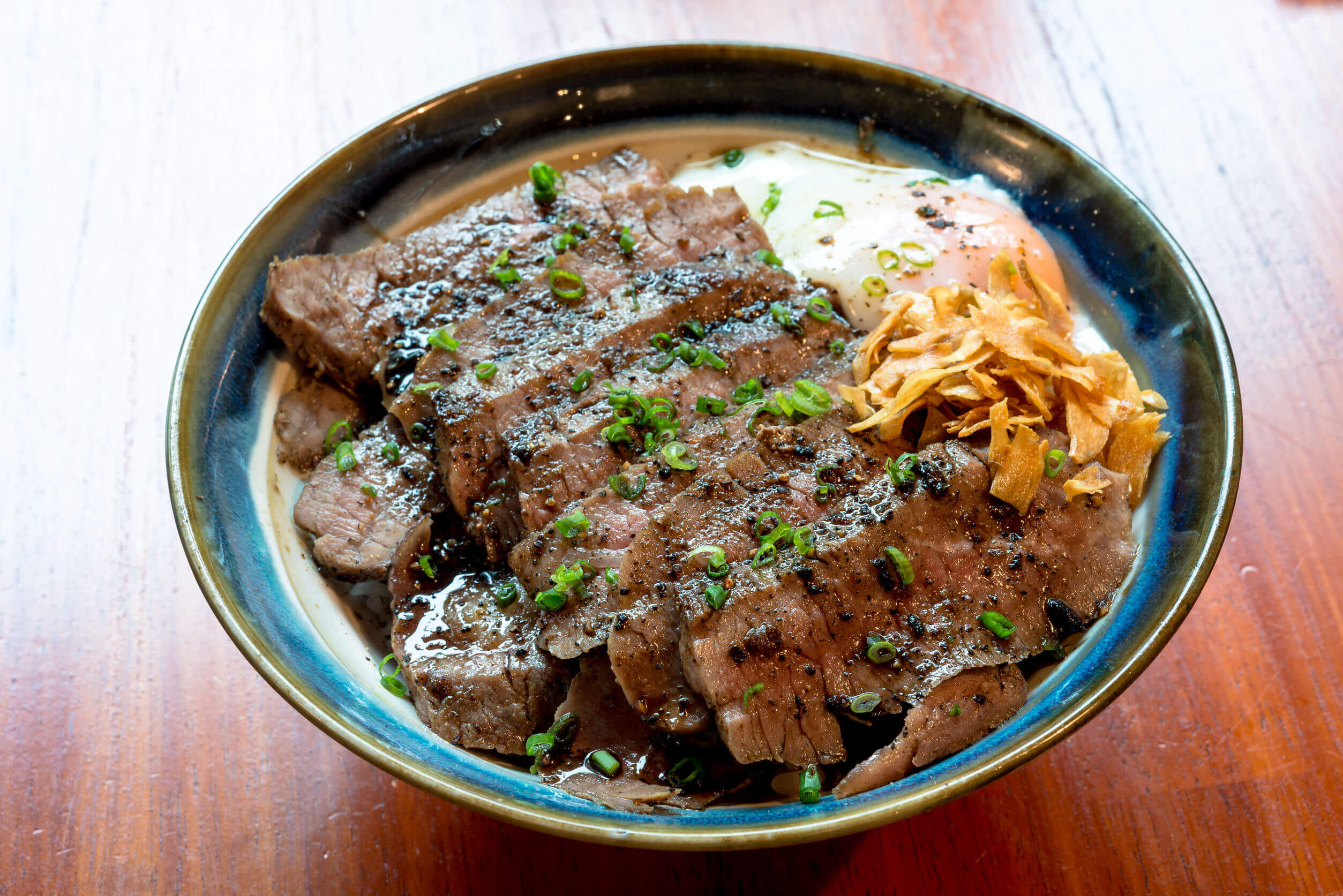 Beef Steak Donburi with egg and fried garlic