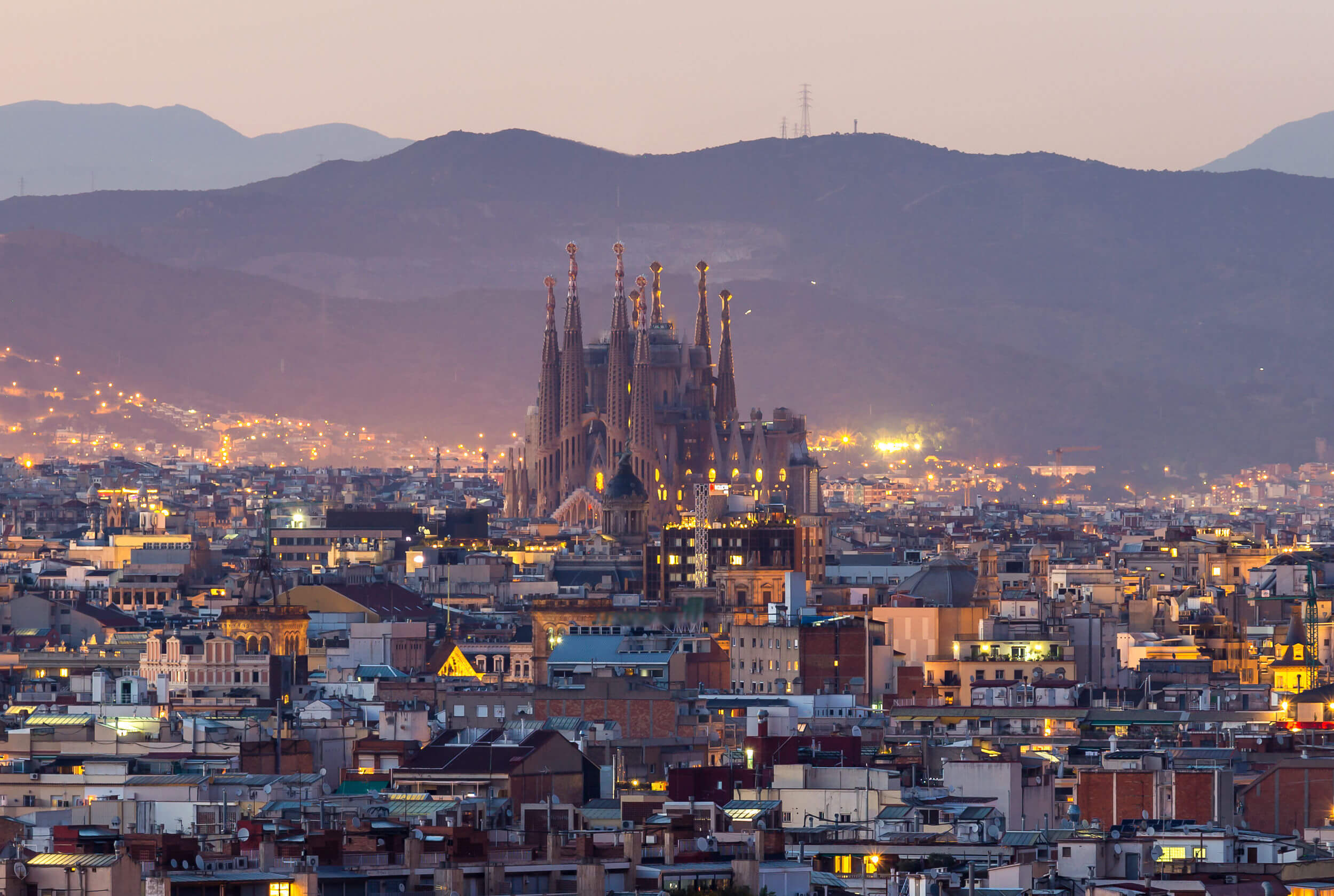 Panorama view of barcelona city and sagrada familia at dusk time,Spain